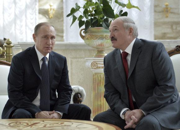 """""""Reuters""""/""""Scanpix"""" nuotr./Vladimiras Putinas ir Aliaksandras Lukašenka Minske"""