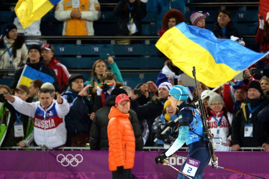 Ukrainos biatlonninkių pergalę lydėjo Rusijos sirgalių keiksmai