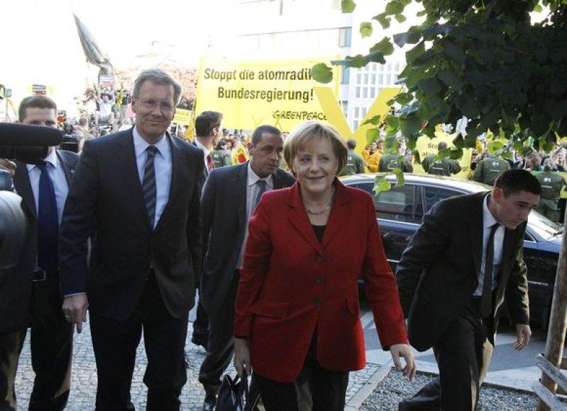 Christianas Wulffas ir Angela Merkel