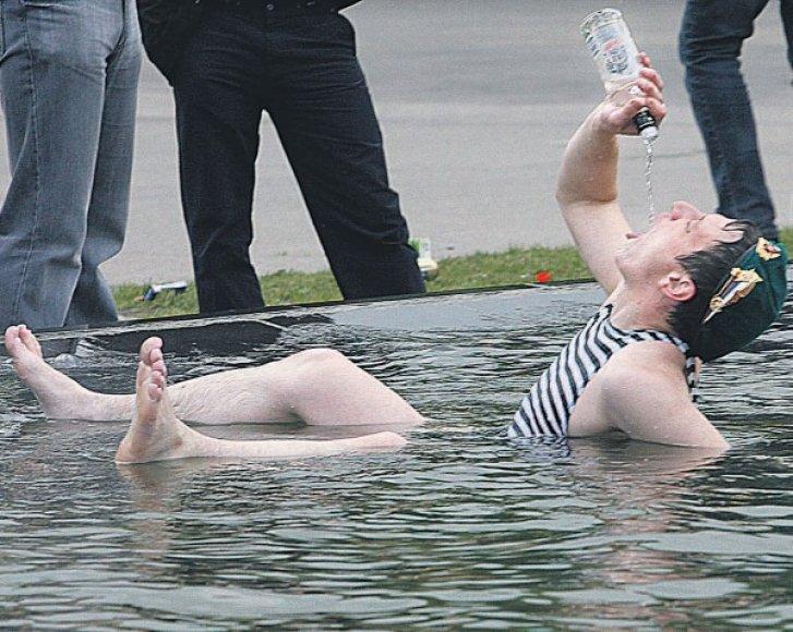 Vyras su buteliu