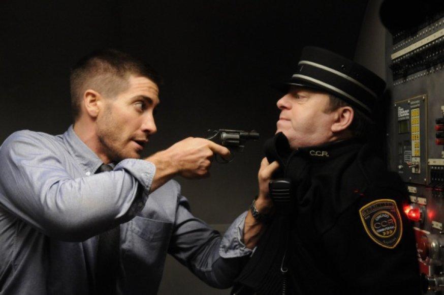 """Karo lakūno Kolterio vaidmenį filme """"Išeities kodas"""" sukūrė aktorius Jake'as Gyllenhaalas (kairėje)."""