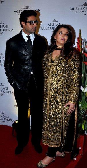 Aishwarya Rai Bachchan ir jos vyras Abhishekas Bachchanas.