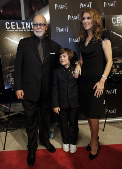 """FILE - In this photo taken Tuesday, Feb. 16, 2010, Celine Dion, right, poses with her husband Rene Angelil, left, and son Rene Charles Angelil, right, as they arrive for the premiere of the film """"Celine: Through the Eyes of the World"""" in Miami Beach, Fla. (AP Photo/Lynne Sladky, File) / SCANPIX Code"""