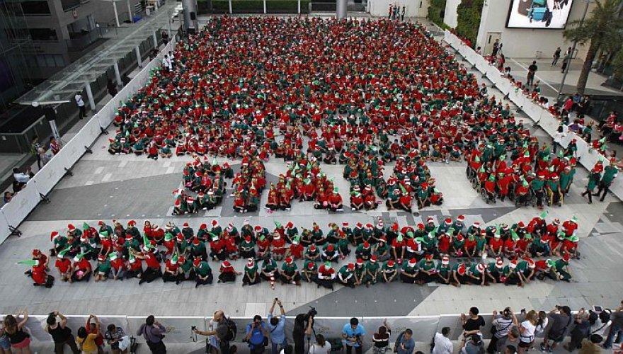 Tailande pasiekto rekordai dalyviai – elfais persirengę vaikai