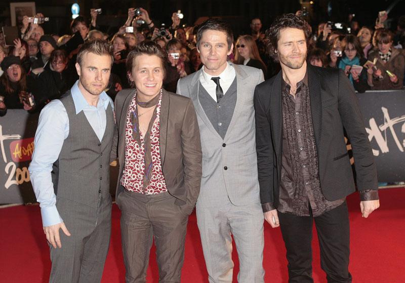 """Foto naujienai: """"Brit Awards"""" nugalėtojai """"Take That"""" ir """"The Arctic Monkeys"""""""