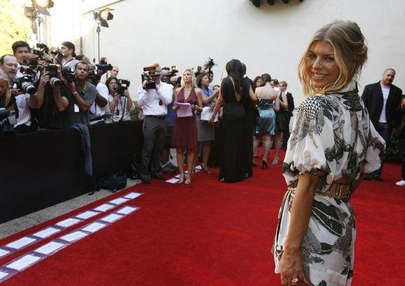 Reuters/Scanpix nuotr./Kaip kito Fergie kūno linijos...