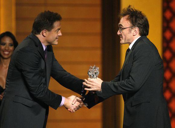 Filmo režisierius priimta apdovanojimą.