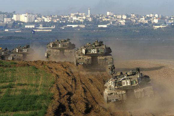 Izraelio pajėgos juda tolyn į Gazos miestą.