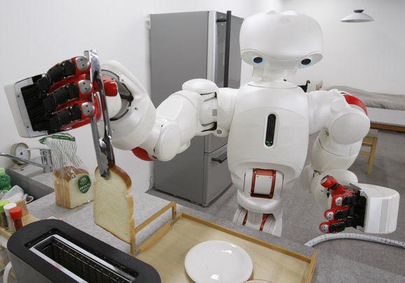 Robotas kepa forminę duoną.