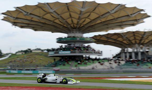 AFP/Scanpix nuotr./Jensonas Buttonas kvalifikacinėse varžybose