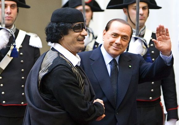 M.Gadhafi Romoje pasveikino Berlusconi.