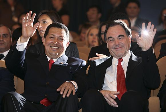 Hugo Chavezas ir Oliveris Stone'as Venecijos kino festivalyje
