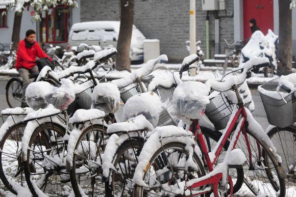 Apsnigti dviračiai