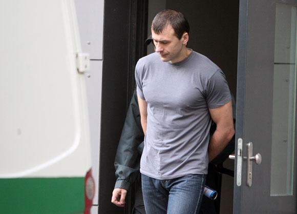 Buvęs apsaugininkas Olegas Krugliakovas, kaltinamas mirtinai sumušęs girtą vyriškį.