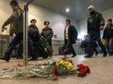 """""""Reuters""""/""""Scanpix"""" nuotr./Žuvusiuosius Domodedovo oro uoste primena gėlės."""
