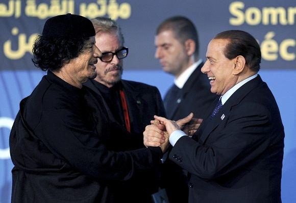 Scanpix nuotr./Libijos diktatorius Muammaras Khadafi