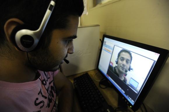 """""""Reuters""""/""""Scanpix"""" nuotr./""""Skype"""" vaizdo pokalbis"""