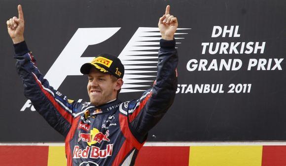 AFP/Scanpix nuotr./Turkijos GP nugalėtojas - Sebastianas Vettelis