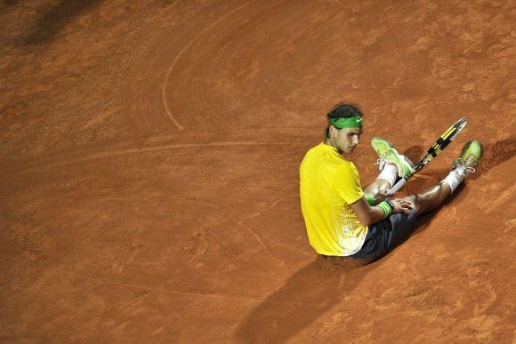 AFP/Scanpix nuotr./Rafaelis Nadalis ketvirtą kartą aiame sezone buvo priverstas pripažinti N.Džokovičiaus pranaaumą.