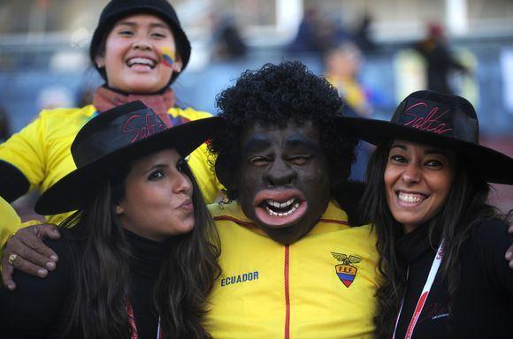 AFP/Scanpix nuotr./Pietų Amerikos futbolo fanai itin spalvingi