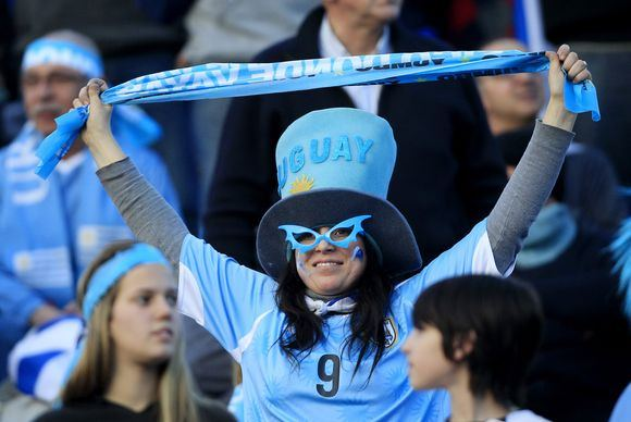 Reuters/Scanpix nuotr./Pietų Amerikos futbolo fanai itin spalvingi