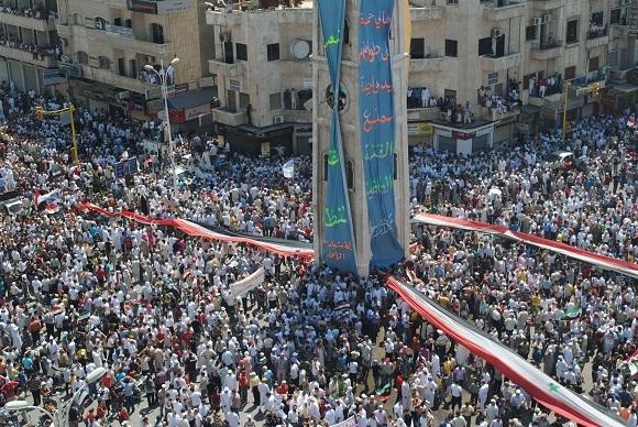 Reuters/Scanpix nuotr./Masiniai protestai Sirijoje
