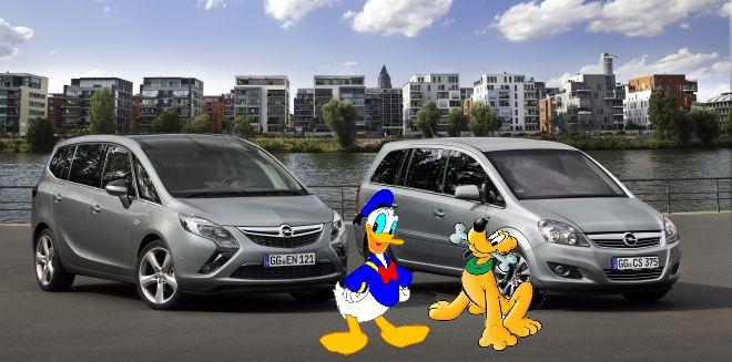 """Ančiukas Donaldas ir šuniukas Plutas prie """"Opel"""" automobilių"""