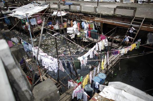 Reuters/Scanpix nuotr./Manilos lūanynai labai skiriasi nuo centro