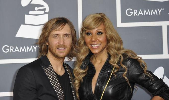 AFP/Scanpix nuotr./Davidas Guetta su žmona Cathy