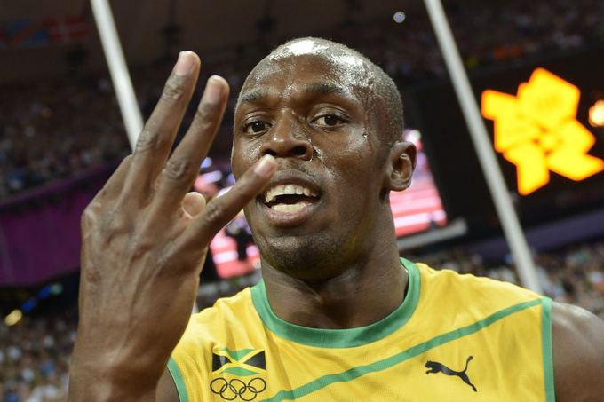 AFP/Scanpix nuotr./Londono olimpiadoje Usainas Boltas iakovojo tris aukso medalius.