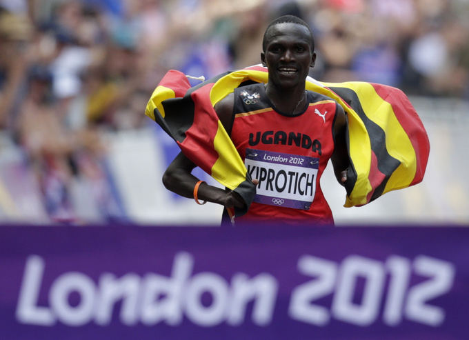"""""""Reuters""""/""""Scanpix"""" nuotr./Olimpinis maratono bėgimo čempionas Stephenas Kiprotichas"""