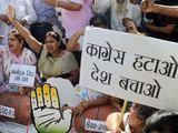 Scanpix nuotr./Protestuotojai Indijoje