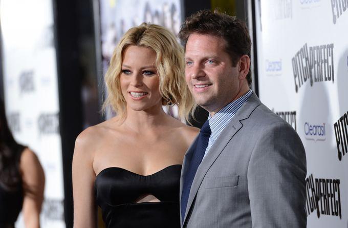 AFP/Scanpix nuotr./Aktorė Elizabeth Banks su vyru Maxu Handelmanu