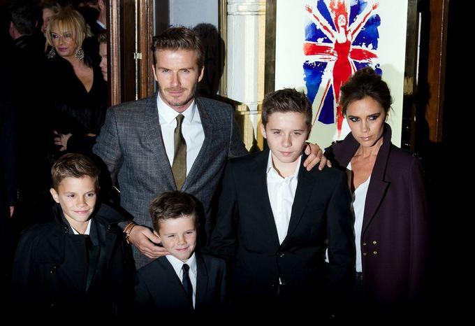 AFP/Scanpix nuotr./Davidas ir Victoria Beckhamai su vaikais