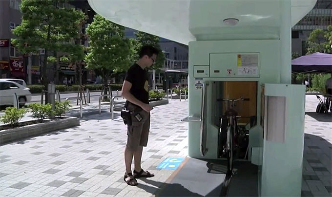 Kadras ia vaizdo siužeto/Eco Cycle požeminė dviračių saugykla