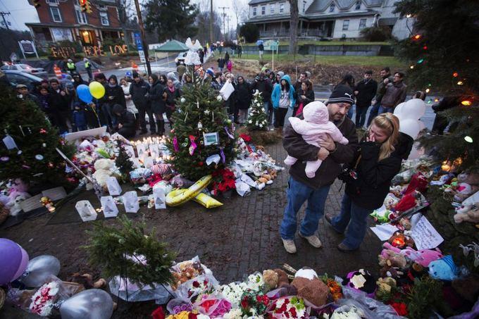Reuters/Scanpix nuotr./Gedintys Niutauno žmonės