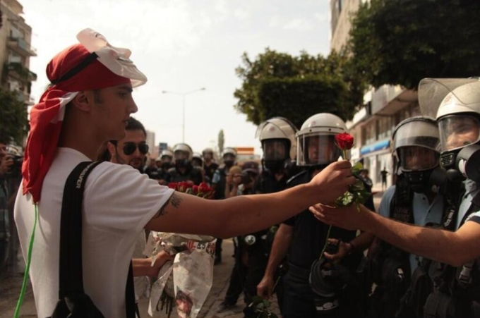 Protestors giving policemen flowers