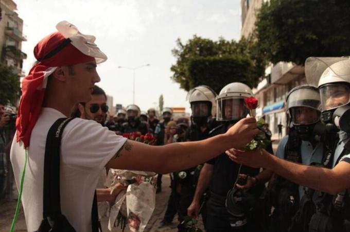 Protestors giving policemen flowers