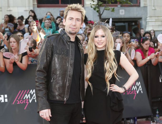 """Reuters""/""Scanpix"" nuotr./Chadas Kroegeris ir Avril Lavigne"