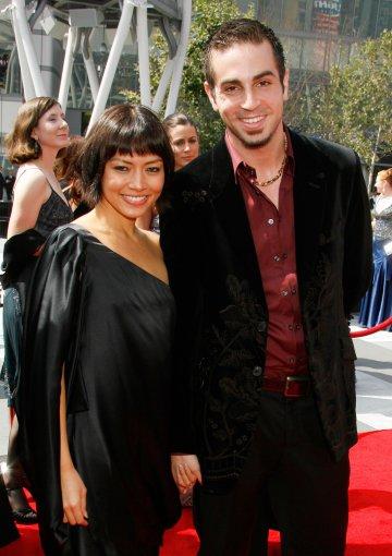 """""""Scanpix"""" nuotr./Wade'as Robsonas su žmona Amanda"""