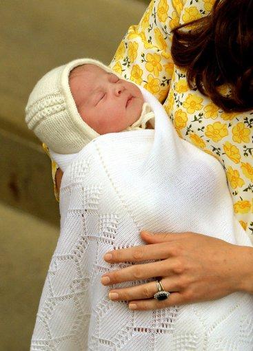 """""""Scanpix""""/""""PA Wire""""/""""Press Association Images"""" nuotr./Kembridžo hercogienės Catherine ir princo Williamo dukra"""