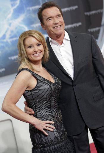 """Scanpix"" nuotr./Heather Milligan ir Arnoldas Schwarzeneggeris"