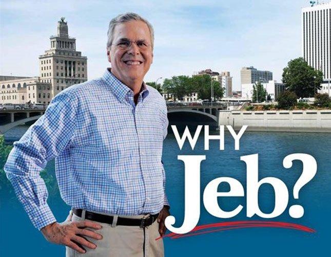 Rinkiminės kompanijos nuotr./Politikui Jebui Bushui prilipdyta juodaodžio ranka