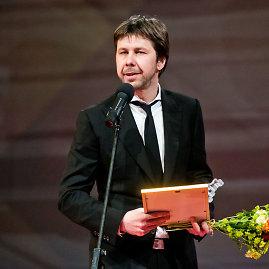 """Gretos Skaraitienės/Žmonės.lt nuotr./Geriausios 2013 m. televizijos laidos """"Auksinis balsas"""" prodiuseris Modestas Karnaševičius"""