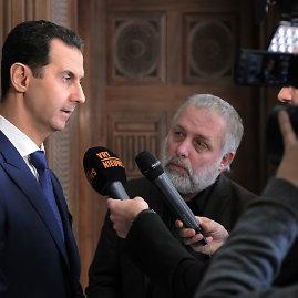 "AFP/""Scanpix"" nuotr./B.al Assadas duoda interviu žurnalistams iš Belgijos."