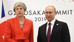 Pro internautų akis nepraslydo ledinė Th.May veido išraiška per susitikimą su  V.Putinu