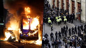 Protestas D.Britanijoje virto riaušėmis: įsiutę demonstrantai degina policijos automobilius