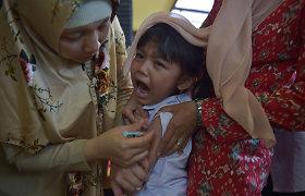 Stabdydama mirtiną difterijos protrūkį Indonezija skiepija milijonus vaikų