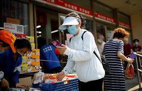 Pekino priemiestyje pasiskiepijusiems nuo COVID-19 gyventojams pasiūlyti nuolaidų kuponai