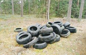 Seimas siekia uždrausti perpus perpjautas ar supresuotas padangas laikyti perdirbtomis